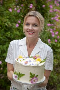 Juliet Sear with a flowery cake